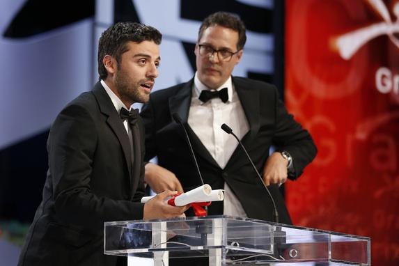 Oscar Isaac et Olivier Courson - Grand Prix - Inside Llewyn Devis © AFP